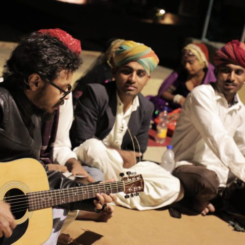 Rizwaan playing guitar and jamming with local artists of Jaisalmer