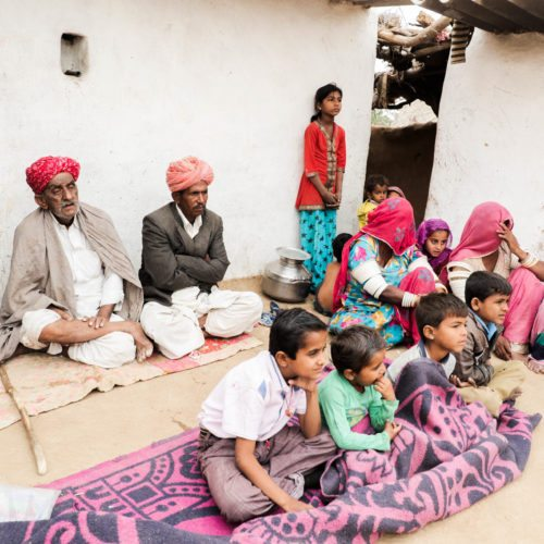 Family and neighbors of Dapu Khan viewing the documentation process.
